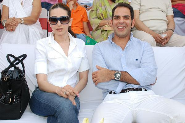 <b>5.Karishma Kapoor-Sanjay Kapoor</b> <p> Kareena is not the first Kapoor sister to tie the knot with a man who  has been married once already. In 2003, her elder sister Karishma  married industrialist Sanjay Kapur. Sanjay was once married to designer  and socialite Nandita Mahtani. Karishma and Sanjay now have two kids,  Samaira and Kiaan.</p>