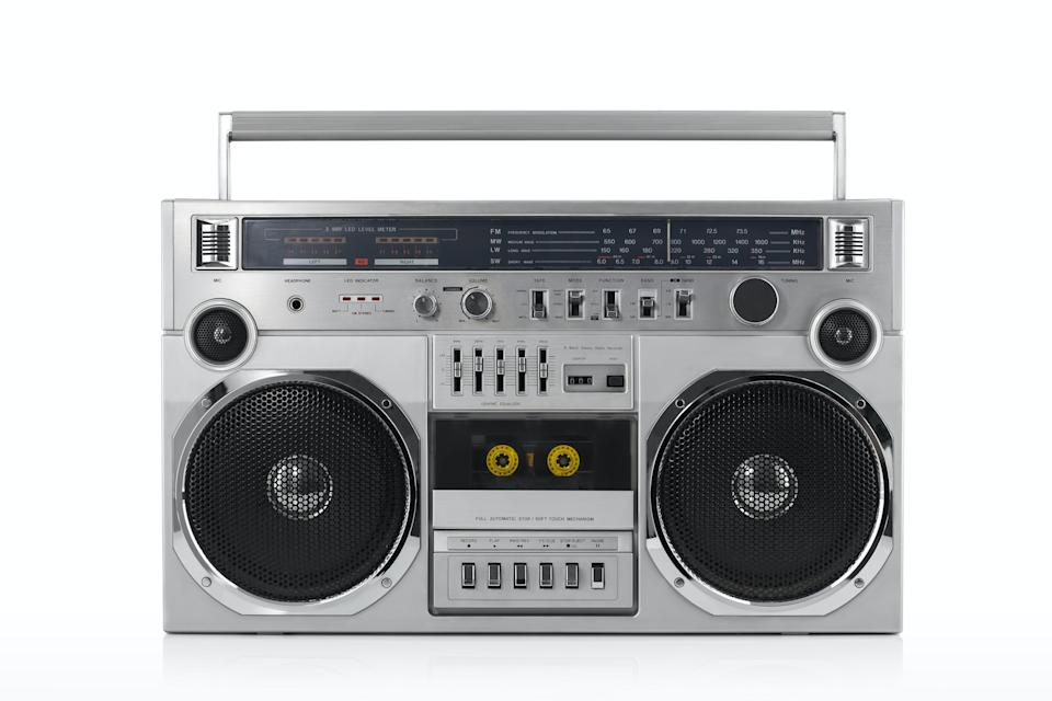 A silver boombox with a cassette tape holder in the middle