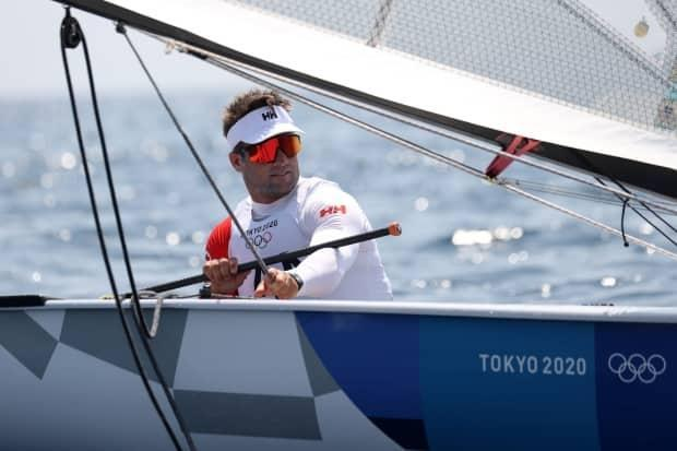 Canadian Tom Ramshaw of Team Canada prepares on the water to compete in the men's finn class races on Saturday in Fujisawa, Kanagawa, Japan. (Phil Walter/Getty Images - image credit)