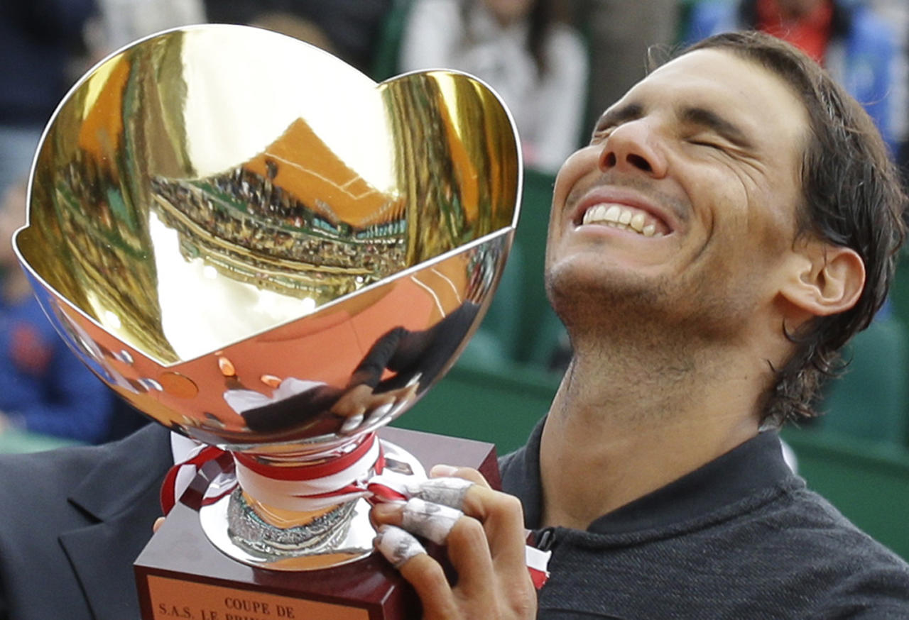 <p>Spain's Rafael Nadal holds up his trophy after winning his men's finals match against Spain's Albert Ramos-Vinolas at the Monte Carlo Tennis Masters tournament in Monaco, Sunday, April, 23, 2017. (Claude Paris/AP) </p>