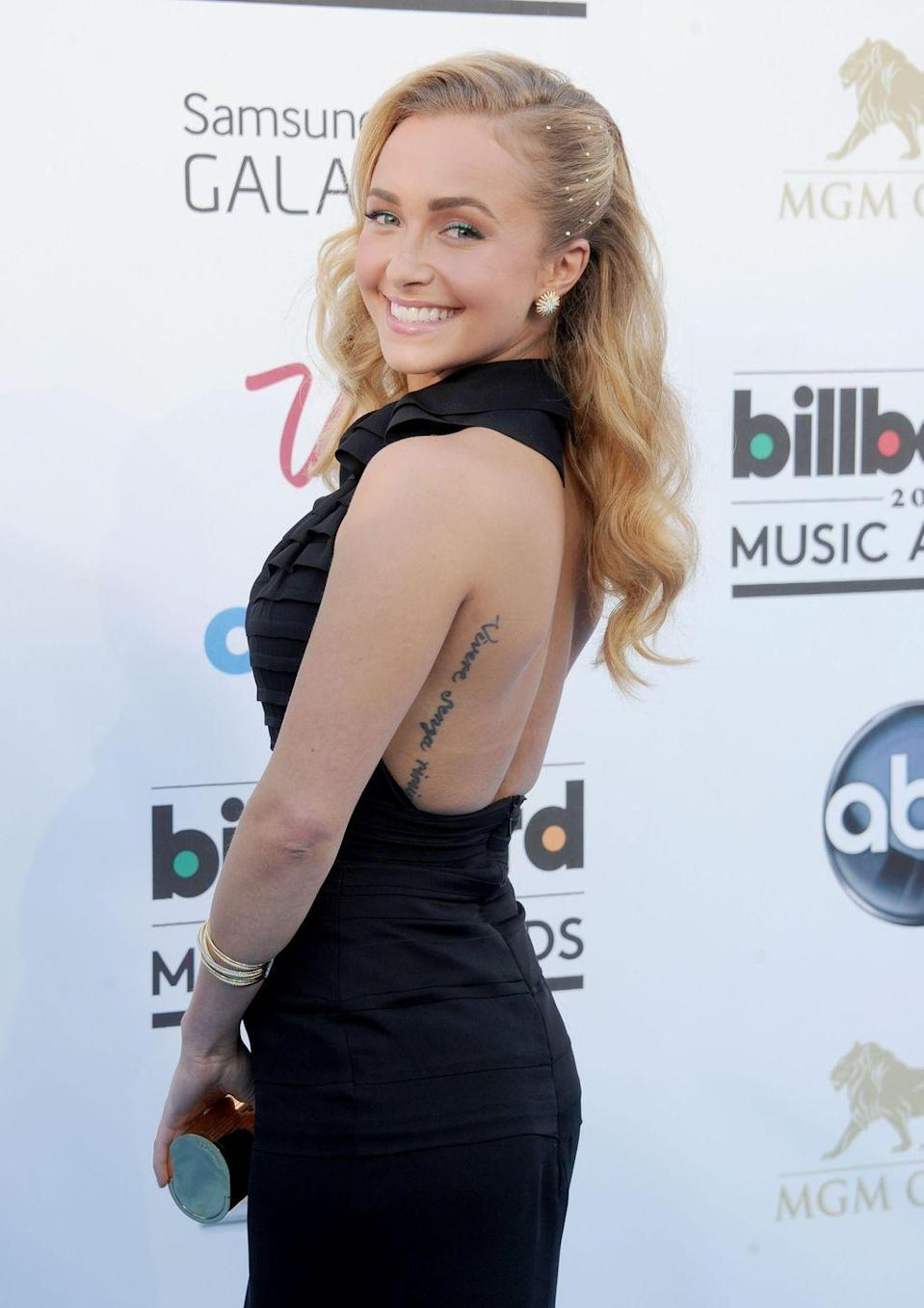 """<p>If you haven't learned yet that you should always (always!) spellcheck your tattoos, Hayden Panettiere is here with another friendly reminder. While the Nashville star intended to get inked with the phrase """"Live without regrets"""" in Italian on her back, the third word is intentionally misspelled with an extra """"i.""""</p><p>While Hayden seemed to take the mistake in stride, telling <em><a href=""""https://www.glamour.com/gallery/hayden-panettiere-may-2013-glamour-cover-shoot-gallery"""" rel=""""nofollow noopener"""" target=""""_blank"""" data-ylk=""""slk:Glamour"""" class=""""link rapid-noclick-resp"""">Glamour</a></em> that since it's spelled wrong, """"I literally have to live by that advice,"""" <em><a href=""""https://www.dailymail.co.uk/tvshowbiz/article-2408535/Hayden-Panettiere-displays-partial-removal-misspelled-tattoo-Miami-beach-bikini.html"""" rel=""""nofollow noopener"""" target=""""_blank"""" data-ylk=""""slk:the Daily Mail"""" class=""""link rapid-noclick-resp"""">the Daily Mail</a></em> reported later that the actress was in the process of getting it removed.</p>"""