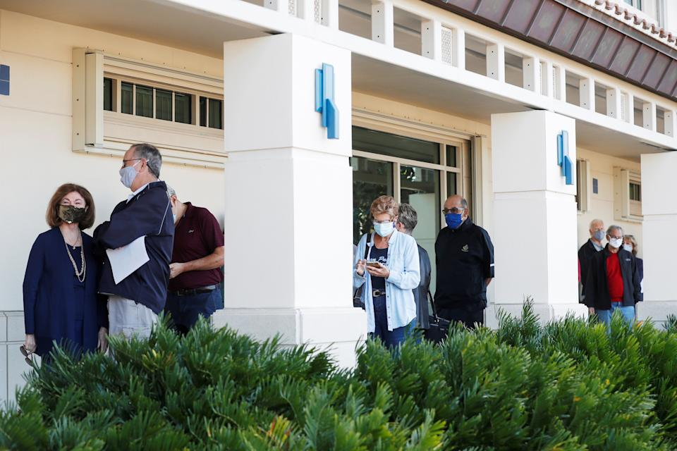 Seniors, who are 65 and over, wait in line at the Department of Health Sarasota COVID-19 vaccination clinic in Sarasota, Florida, U.S. January 4, 2021. REUTERS/Octavio Jones