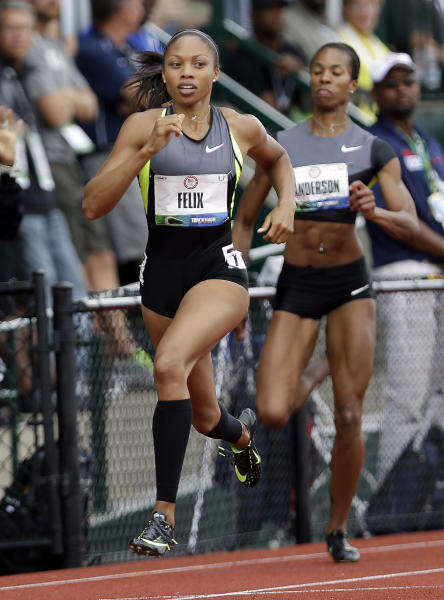 Allyson Felix competes in her heat in the women's 200 meter semi-finals at at the U.S. Olympic Track and Field Trials Friday, June 29, 2012, in Eugene, Ore. Alexandria Anderson is at right. (AP Photo/Marcio Jose Sanchez)