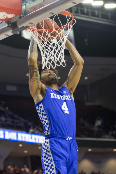 Kentucky forward Nick Richards dunks against Texas A&M during the first half of an NCAA college basketball game Tuesday, Feb. 25, 2020, in College Station, Texas. (AP Photo/Sam Craft)