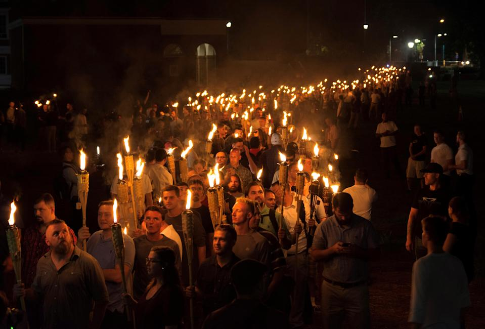 <p>White nationalists carry torches on the grounds of the University of Virginia, on the eve of a planned Unite The Right rally in Charlottesville, Va., Aug. 11, 2017. (Photo: Alejandro Alvarez/News2Share via Reuters) </p>