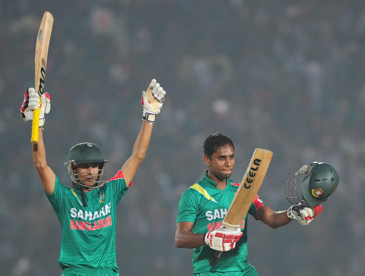 Bangladesh batsmen Sohag Gazi (R) and Nasir Hossain (L) react after winning the third One-Day International (ODI) cricket match between Bangladesh and New Zealand at Khan Jahan Ali Stadium in Fatullah on the outskirts of Dhaka on November 3, 2013 . Bangladesh win the series against New Zealand by 3-0. AFP PHOTO/ Munir uz ZAMAN        (Photo credit should read MUNIR UZ ZAMAN/AFP/Getty Images)