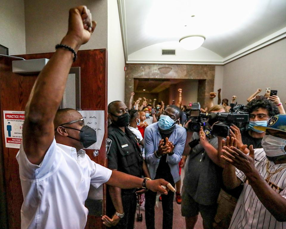 Jay Anderson Sr. and supporters rejoice after Milwaukee County Circuit Judge Glenn H. Yamahiro announced on Wednesday that there is probable cause to charge Joseph Mensah, former Wauwatosa police officer, in the 2016 fatal shooting of Jay Anderson Jr.