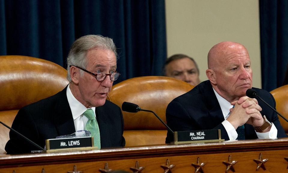 House Ways and Means Committee Chair Rep. Richard Neal, D-Mass., accompanied by ranking member Rep. Kevin Brady, R-Texas, during a House Ways and Means Committee hearing. (AP Photo/Jose Luis Magana)