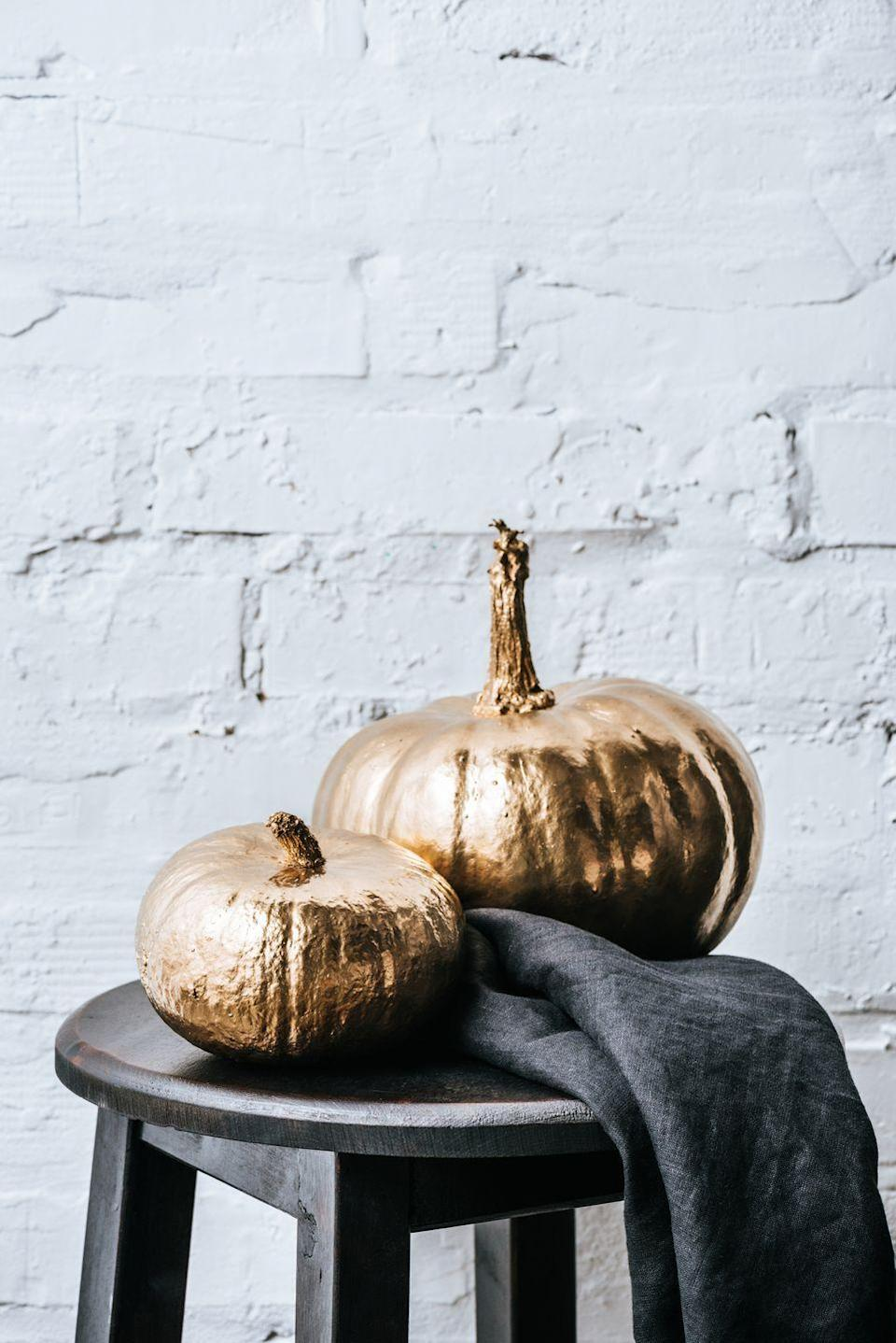 """<p>Who says jack-o-lanterns get to have all the fun? Use crafts like paints, glitter, glue or felt to get extra-creative with your fall pumpkin displays.</p><p>Check out some <a href=""""https://www.oprahmag.com/life/g28337071/easy-pumpkin-carving-ideas/"""" rel=""""nofollow noopener"""" target=""""_blank"""" data-ylk=""""slk:clever decorating and carving ideas here"""" class=""""link rapid-noclick-resp"""">clever decorating and carving ideas here</a>.</p>"""