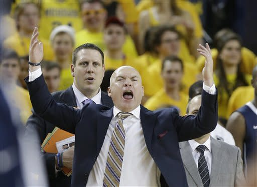 Penn State head coach Pat Chambers reacts during the second half of an NCAA college basketball game against Michigan at Crisler Center in Ann Arbor, Mich., Sunday, Feb. 17, 2013. (AP Photo/Carlos Osorio)
