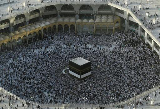 Muslim pilgrims gather in August 2019 around the Kaaba, Islam's holiest shrine, at the Grand Mosque in Saudi Arabia's holy city of Mecca prior to the start of last year's hajj pilgrimage