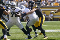 Pittsburgh Steelers outside linebacker T.J. Watt (90) forces a fumble as he sacks Las Vegas Raiders quarterback Derek Carr (4) during the first half of an NFL football game in Pittsburgh, Sunday, Sept. 19, 2021. The Raiders recovered the ball. (AP Photo/Keith Srakocic)