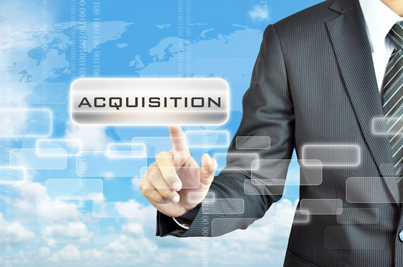 Businessman pointing to the word acquisition