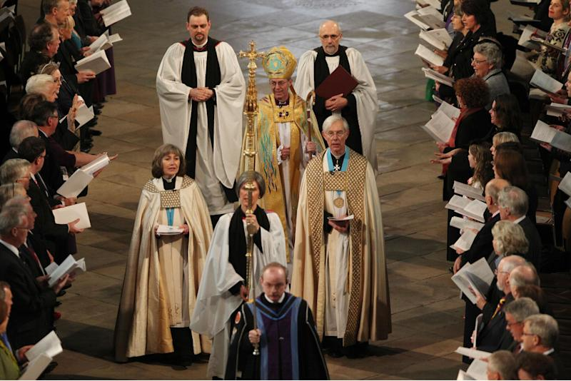 The new Archbishop of Canterbury Justin Welby, centre, arrives for his enthronement service at Canterbury Cathedral in Canterbury England Thursday March 21, 2013. (AP Photo/ Gareth Fuller/Pool)