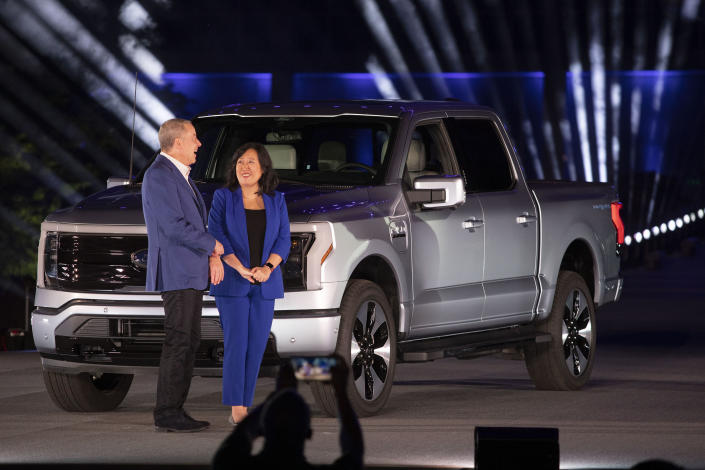 DEARBORN, MI - MAY 19: Bill Ford, Jr., Executive Chairman of Ford Motor Company and Linda Zhang, Chief Engineer, attend the reveal of the new all-electric Ford F-150 Lightning pickup truck at Ford World Headquarters on May 19, 2021 in Dearborn, Michigan. The truck will be built at the all-new Ford Rouge Electric Vehicle Center in Dearborn starting in the Spring of 2022. (Photo by Bill Pugliano/Getty Images)