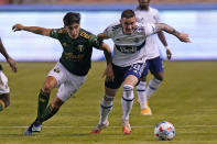 Vancouver Whitecaps defender Jake Nerwinski (28) and Portland Timbers defender Claudio Bravo (5) battle for the ball in the first half during an MLS soccer game Sunday, April 18, 2021, in Sandy, Utah. (AP Photo/Rick Bowmer)