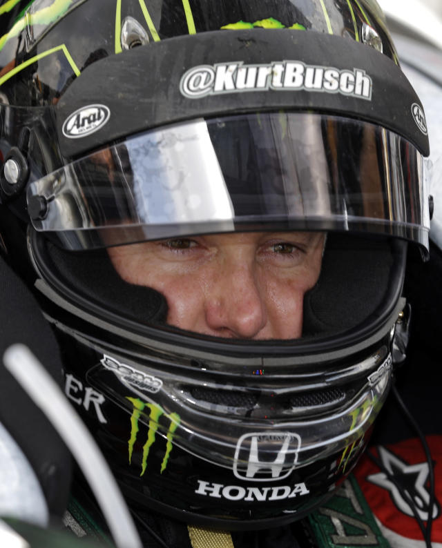 Kurt Busch sits in the cockpit of his car during a break in practice for Indianapolis 500 IndyCar auto race at the Indianapolis Motor Speedway in Indianapolis, Tuesday, May 13, 2014. On Memorial Day weekend, NASCAR's bad boy is trying to own the title of baddest man on the track by pulling off racing's version of an IronMan triathlon. In a single day, he'll try and race in the Indianapolis 500 and the Coca-Cola 600, with a race or two against the clock thrown in. (AP Photo)
