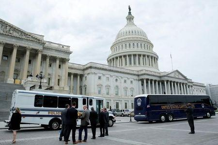 Buses with members of Congress leave Capitol Hill to the White House after the U.S. House approved a bill to repeal major parts of Obamacare and replace it with a Republican healthcare plan in Washington