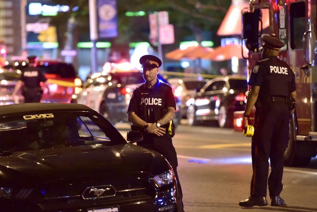 <p>Police work the scene of a shooting in Toronto on Sunday, July 22, 2018. (Photo: Frank Gunn/The Canadian Press via AP) </p>