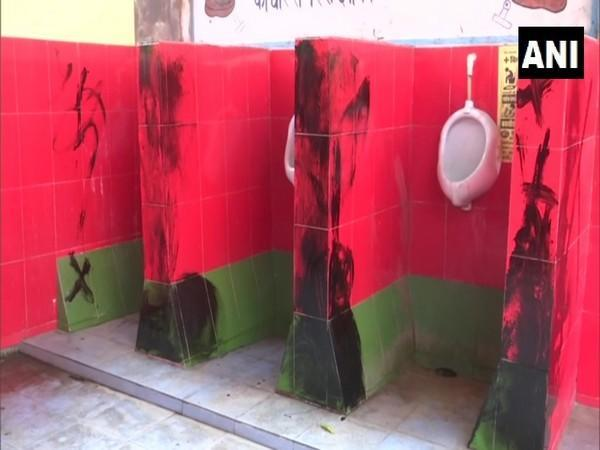 Party workers alleged that Samajwadi Party's symbolic green and red colors were used in the tiles of a toilet in Gorakhpur Railway Hospital. (Photo/ANI)