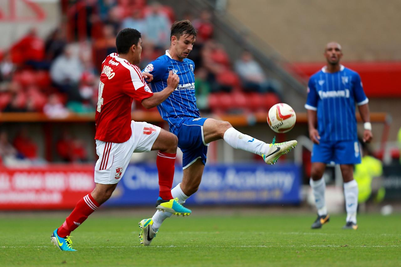 Gillingham's Steven Gregory and Swindon's Massimo Luongo during the Sky Bet Football League One match at the County Ground, Swindon.