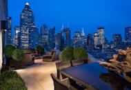 "<p>Sweeping city views with all-black and wood decor is the epitome of a New York City rooftop. </p><p><em>Design by </em><a href=""http://designers.elledecor.com/interior-designers/michael-dawkins-home"" rel=""nofollow noopener"" target=""_blank"" data-ylk=""slk:Michael Dawkins Home"" class=""link rapid-noclick-resp""><em>Michael Dawkins Home</em></a></p>"