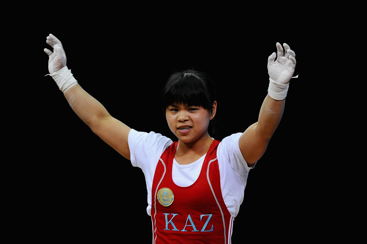 LONDON, ENGLAND - JULY 29:  Zulfiya Chinshanlo of Kazakhstan reacts after competing in the Women's 53kg Weightlifting on Day 2 of the London 2012 Olympic Games at ExCeL on July 29, 2012 in London, England.  (Photo by Laurence Griffiths/Getty Images)