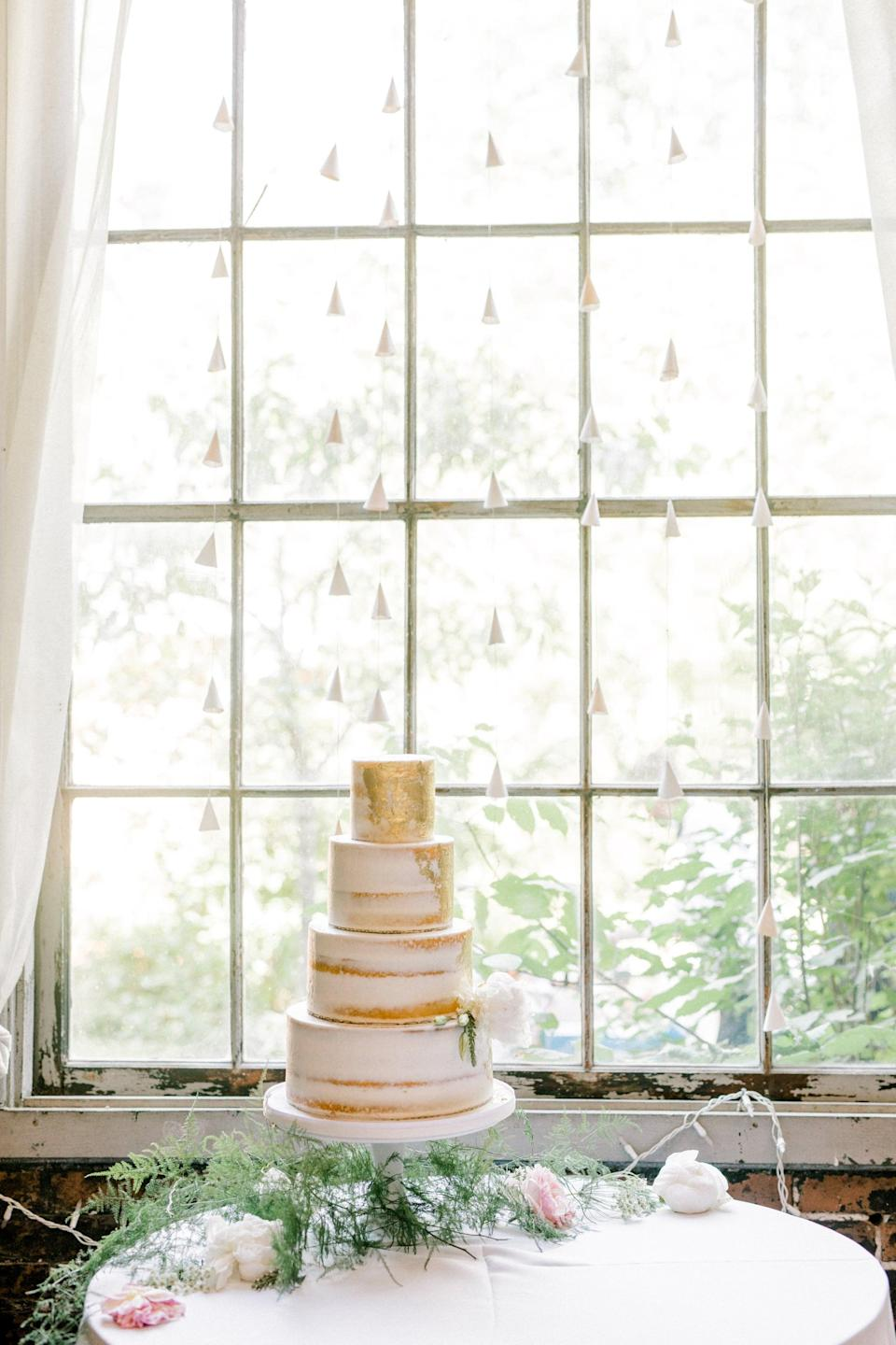 """<p>Make every area of your venue worthy of a photo op when you create a <a class=""""link rapid-noclick-resp"""" href=""""https://www.popsugar.com/latest/DIY"""" rel=""""nofollow noopener"""" target=""""_blank"""" data-ylk=""""slk:DIY"""">DIY</a> backdrop. You can get creative and use little tassels (shown in the photo), faux plant vines, and more to elevate any space. We love how this backdrop highlights the cake and draws attention to it.</p>"""