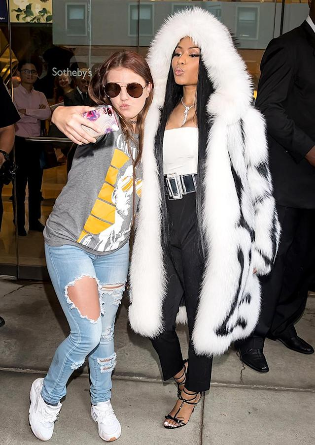 <p>Don't expect to take a boring selfie with Minaj. The rapper was happy to pucker up with a fan as she left the Oscar de la Renta show at New York Fashion Week. (Photo: Gilbert Carrasquillo/GC Images) </p>