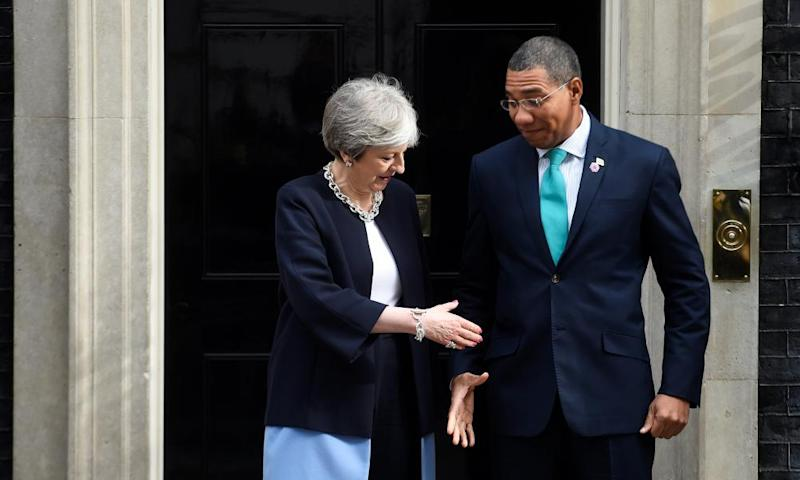 Theresa May and Jamaica's PM Andrew Holness.