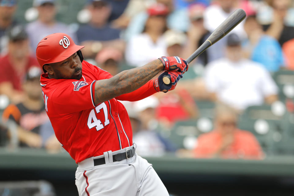 FILE - In this March 10, 2020, file photo, Washington Nationals designated hitter Howie Kendrick swings at a pitch from Miami Marlins' Caleb Smith during the second inning of a spring training baseball game in Jupiter, Fla. Designated hitters will be used in National League games this season. (AP Photo/Julio Cortez, File)