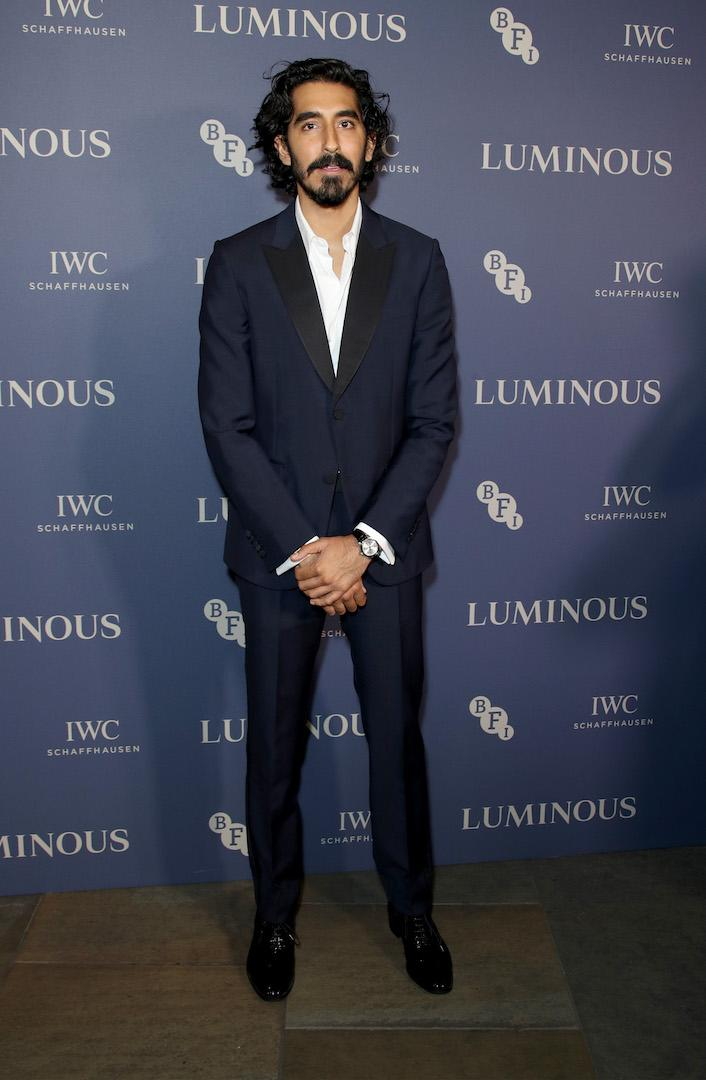 Wearing a navy suit with a relaxed white shirt peeping from beneath. <em>[Photo: Getty]</em>