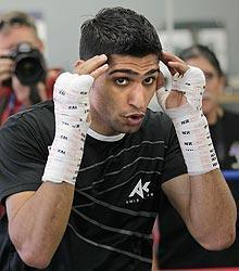 Amir Khan (above) has been training with Manny Pacquiao for over a year