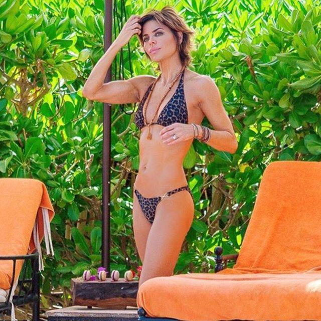 <p>Rinna showed off her toned abs and arms in this poolside snap. </p>