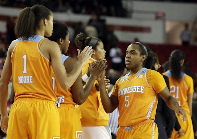 Tennessee guard Ariel Massengale (5) celebrates with her teammates as she leaves the game in the fianl moments of the second half of an NCAA college basketball game after the game against Georgia, Sunday, Jan. 5, 2014, in Athens, Ga. Tennessee won 85-70. (AP Photo/John Bazemore)