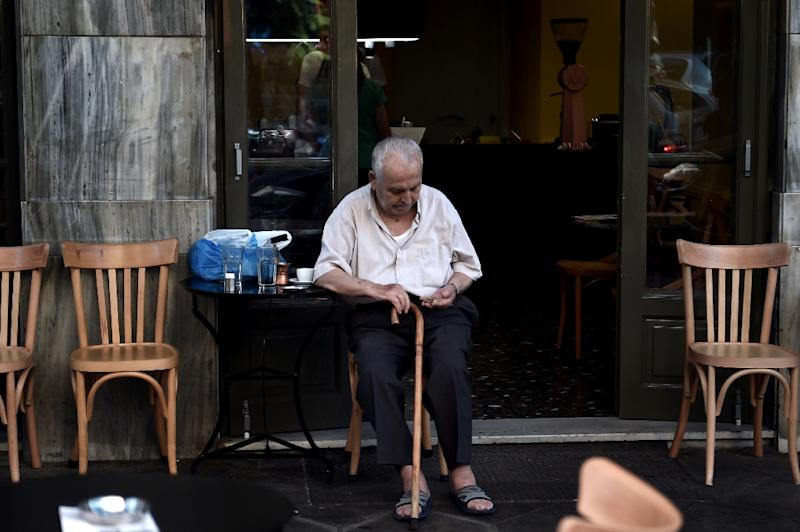 An old man sits in a coffee shop in central Athens on July 13, 2015 as debt-ridden Greece reached a desperately-needed bailout deal with creditors (AFP Photo/Aris Messinis)