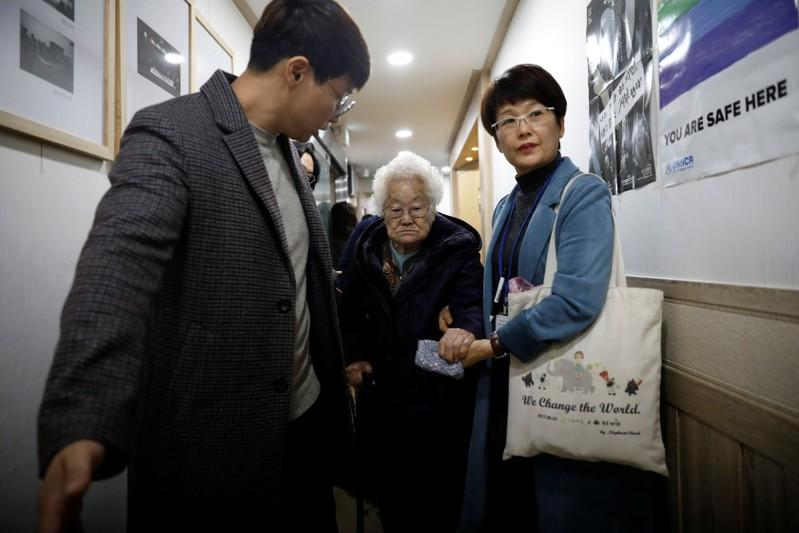 """Former South Korean """"comfort woman"""" Lee Ok-sun leaves after a news conference in Seoul"""