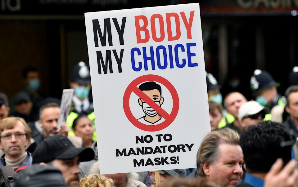Anti-lockdown protesters take part in a march in London on SaturdayREUTERS