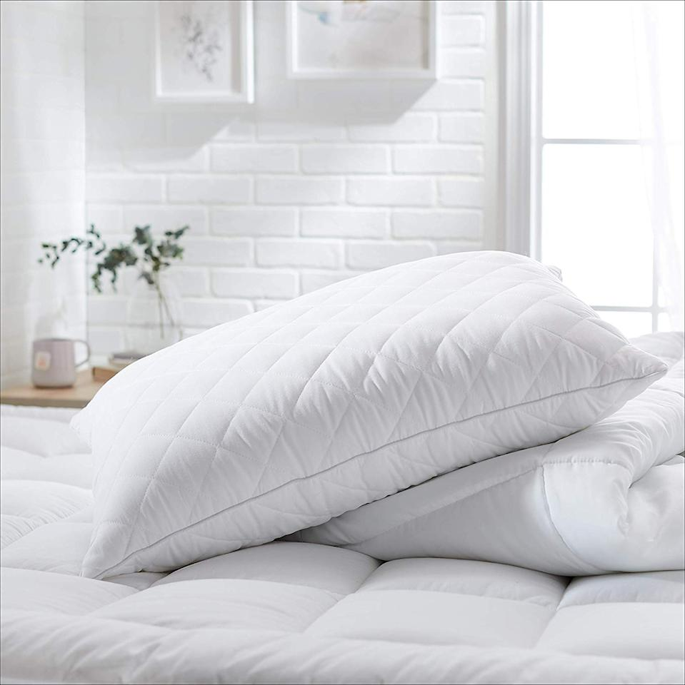 These plush pillows gently cradle your head for the best sleep ever. (Photo: Amazon)
