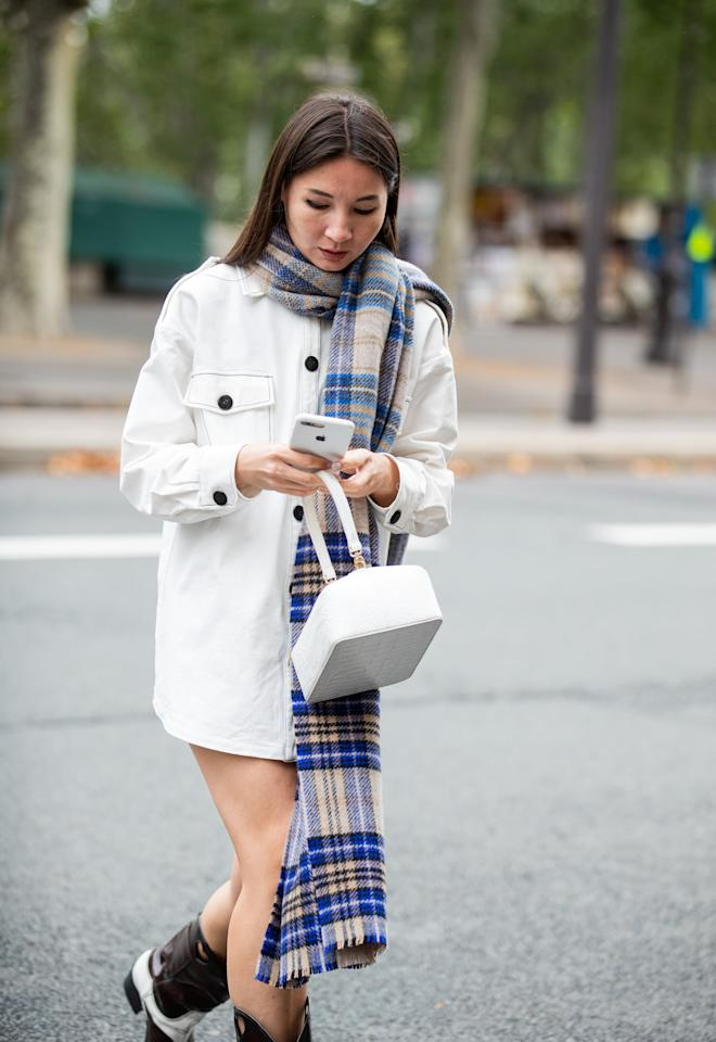 <p>Wrap your long plaid scarf tightly around your neck and let the longer side swing to the front to play with proportions when you're wearing a minidress. Wear mid-rise cowboy boots to give off Western flair.</p>