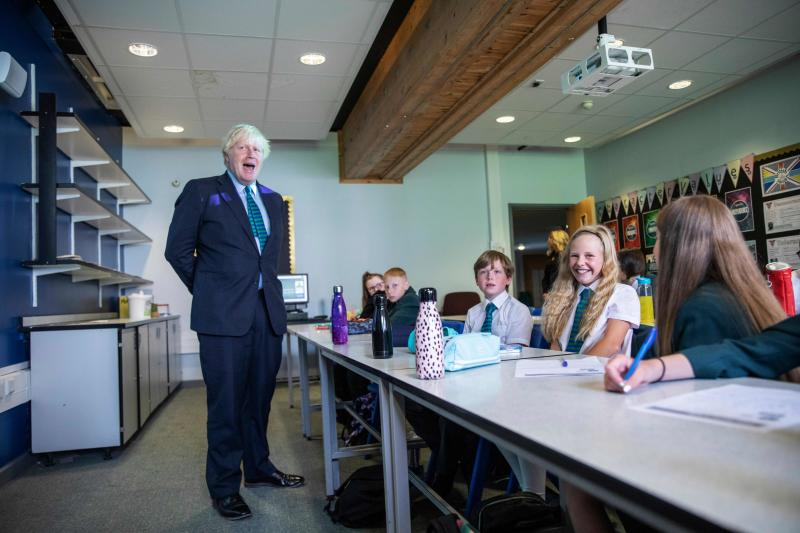 Britain's Prime Minister Boris Johnson talks to a class of year seven pupils on their first day at Castle Rock school, Coalville, central England on August 26, 2020. (Photo by Jack Hill / POOL / AFP) (Photo by JACK HILL/POOL/AFP via Getty Images)