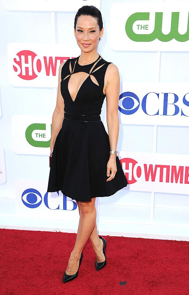 """Not to be outdone, Lucy Liu showed up at the <a target=""""_blank"""" href=""""http://tv.yahoo.com/photos/cbs-tca-summer-press-tour-2012-slideshow/"""">swanky TCA affair</a> in this awesome J. Mendel A-line dress, which featured a plunging neckline and sexy cut-outs. The actress -- whose new CBS show, """"Elementary,"""" premieres on September 27 -- polished things off with a python Judith Leiber clutch and $750 Casadei """"Blade-Heel"""" pumps. (7/29/2012)<br><br><a target=""""_blank"""" href=""""http://twitter.com/YahooOmg"""">Follow omg! on Twitter!</a>"""