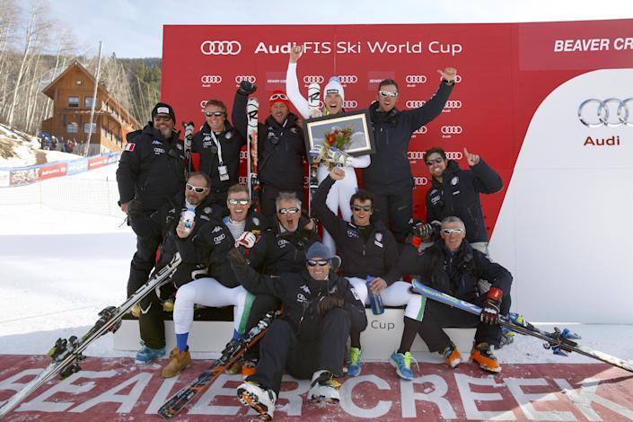 Italy ski team members join Christof Innerhofer, center, on the podium after he won the men's World Cup downhill ski race in Beaver Creek, Colo., on Friday, Nov. 30, 2012. (AP Photo/Alessandro Trovati)
