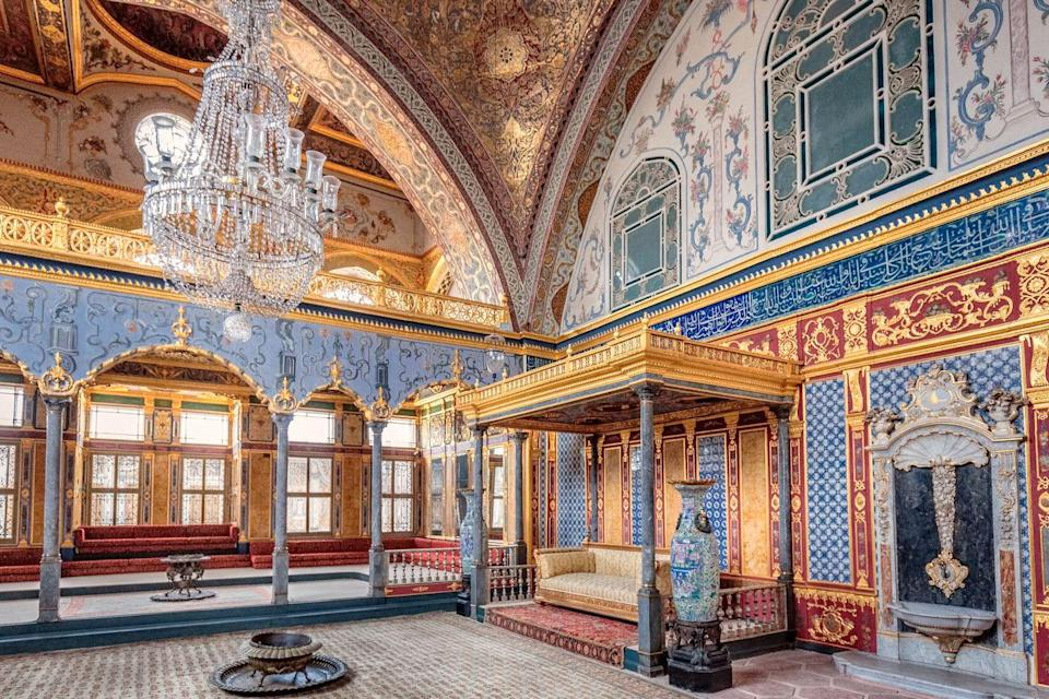 <p>For centuries, the opulent pavilions and verdant courtyard of the Topkapi Palace were considered the crown jewel of the Ottoman Empire. Sultan Mehmed II ordered the construction of the city-palace after his conquest of Constantinople in 1459. </p><p>The First Courtyard acted as a service area consisting of a hospital, bakery, and dormitories for the members of the sultan's court and harem, whereas the Second Courtyard served as a meeting place for the Divan (Imperial Council). While the palace is no longer used for official state affairs, the colorful mosaic tiles and gold Arabic script carved into the carried on its regal and luxurious legacy. </p>