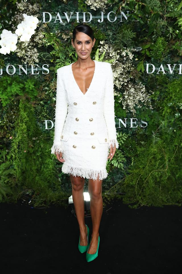 <p>Newlywed Lindy Klim made her first appearance as a married woman in a white, fringed blazer dress and popping, green shoes. Photo: Getty Images </p>