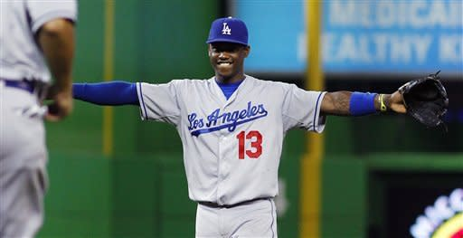 Los Angeles Dodgers' Hanley Ramirez celebrates with Juan Rivera, left, after their 5-0 win over the Miami Marlins in a baseball game in Miami, Sunday, Aug. 12, 2012. (AP Photo/J Pat Carter)