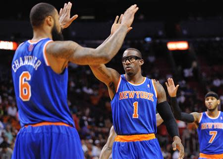 Apr 6, 2014; Miami, FL, USA; New York Knicks forward Amar'e Stoudemire (1) high fives teammate center Tyson Chandler (6) during the first half against the Miami Heat at American Airlines Arena. Steve Mitchell-USA TODAY Sports
