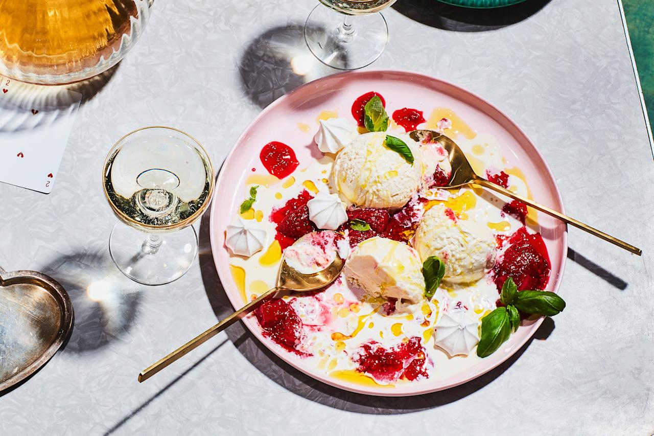 """Store-bought meringue cookies and frozen berries make this elegant sundae come together in a snap. Serve it on one big plate with two spoons for a sweet ending to a romantic dinner. <a href=""""https://www.epicurious.com/recipes/food/views/meringue-sundae-with-peppery-berry-sauce?mbid=synd_yahoo_rss"""">See recipe.</a>"""