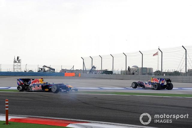 """Mark Webber, Red Bull Racing RB6 Renault and Sebastian Vettel, Red Bull Racing RB6 Renault crash and spin <span class=""""copyright"""">LAT Images</span>"""