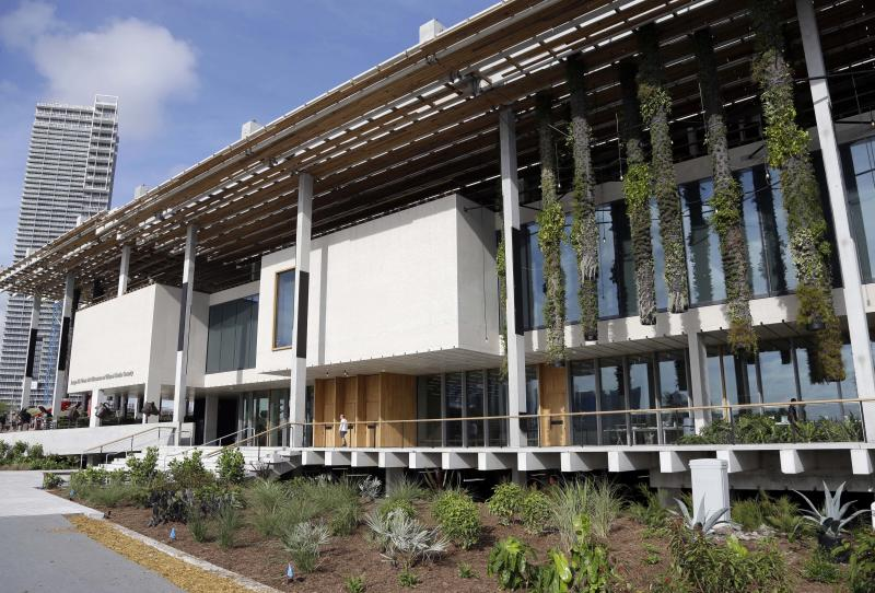 In this Thursday, Dec. 12, 2013 photo, is the Perez Art Museum Miami, in Miami. The museum was designed by the Pritzker Prize-winning architect firm Herzog & de Meuron who took pains to design both an airy and hurricane resistant building with a wide wraparound deck. Massive columns with shrubbery hang like an enchanted forest. The museum, called the PAMM by locals, opened in December and is becoming a must-see destination for tourists and locals alike with its eclectic and provocative collection. (AP Photo/Lynne Sladky)